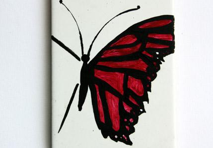piastrella farfalla a metà rosso-viola